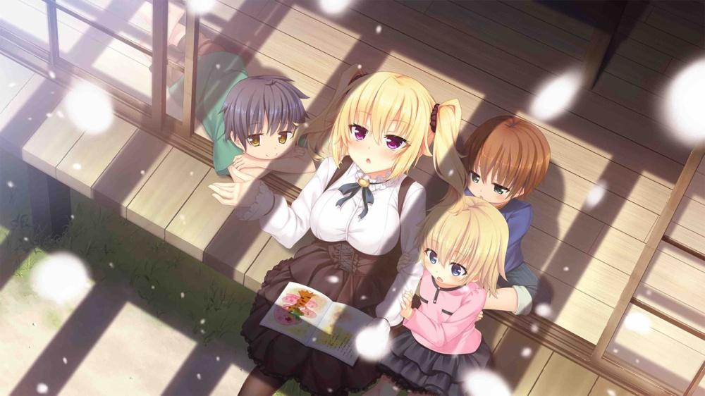 金髪の女の子と子供3人が座っている